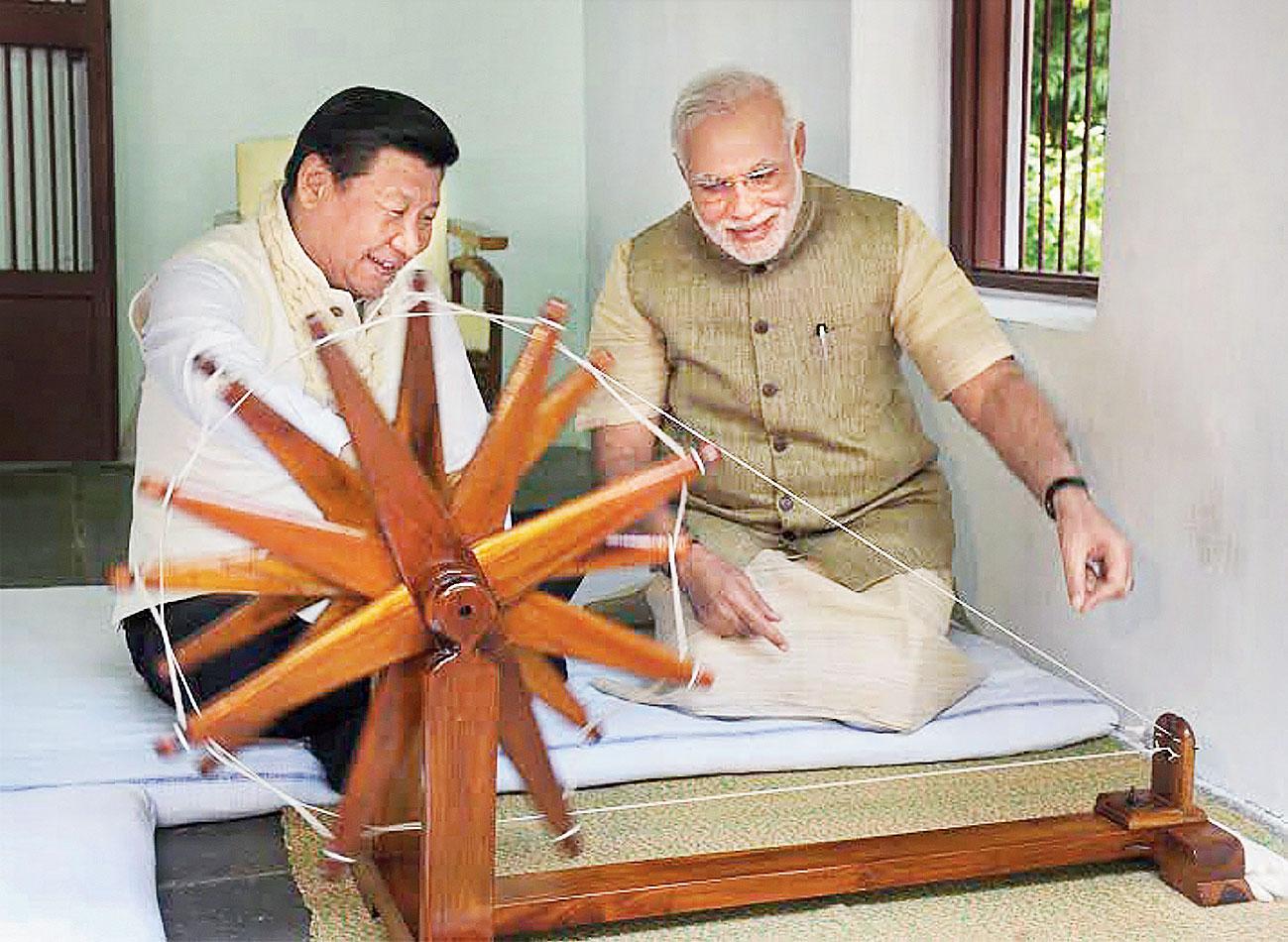 Modi with  Xi at Gandhi Ashram in Ahmedabad in 2014.