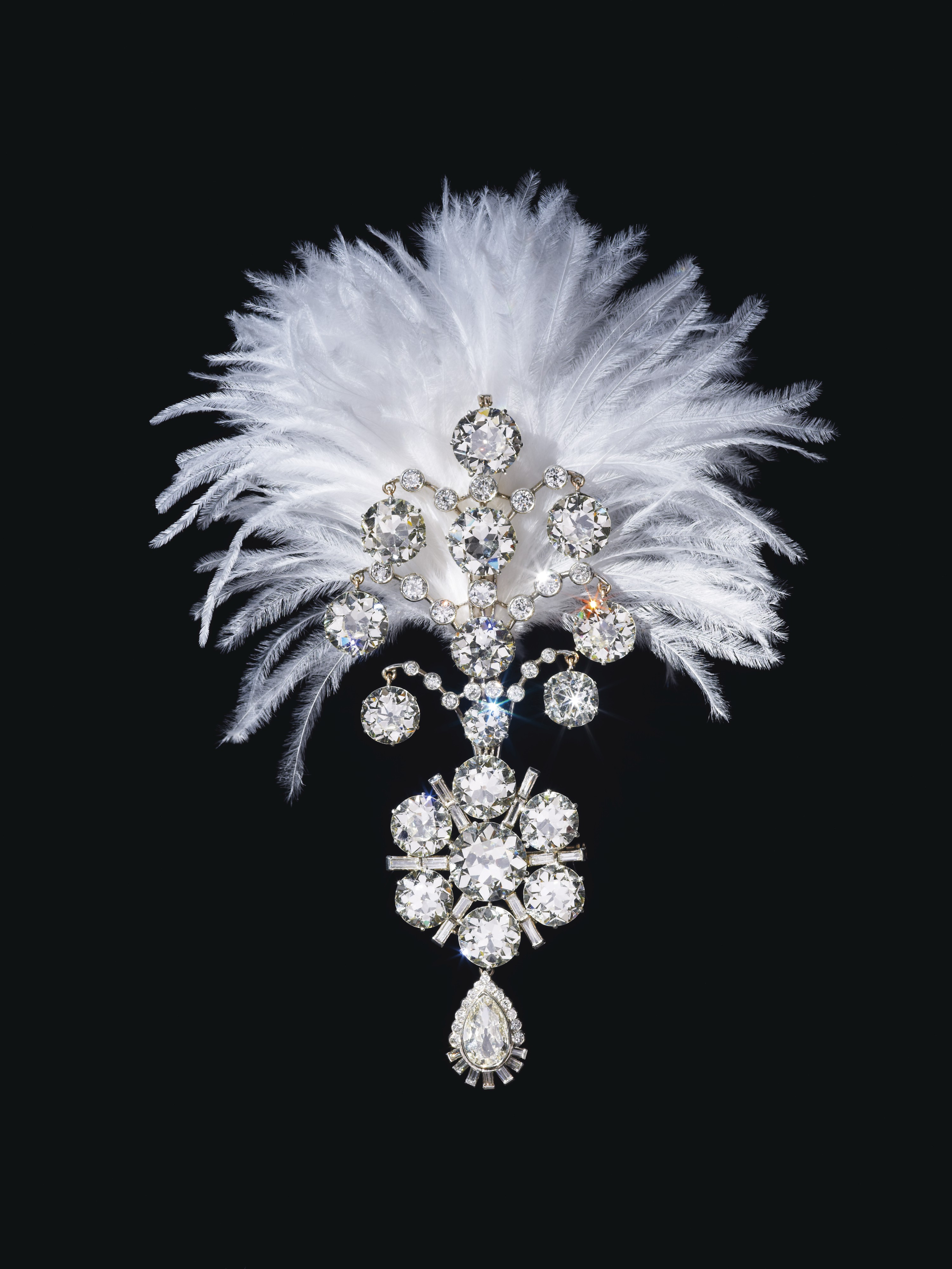 A turban ornament set with old, baguette and pear-shaped diamonds, white gold, fitted with plume holder on the reverse, lower portion detachable and may be worn as a brooch. Created in 1907 and remodeled in 1935. Sold for $1,815,000