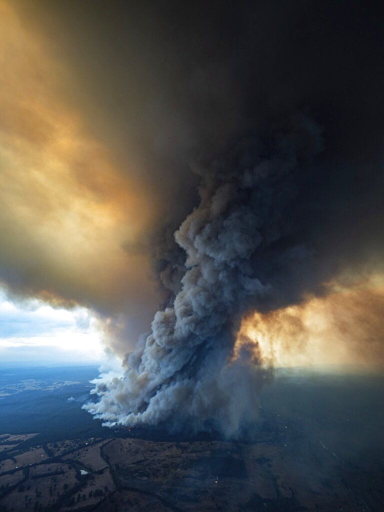 In this image released Thursday, January 2, 2020, from the DELWP Gippland, shows massive smoke rising from wildfires burning in East Gippsland, Victoria.