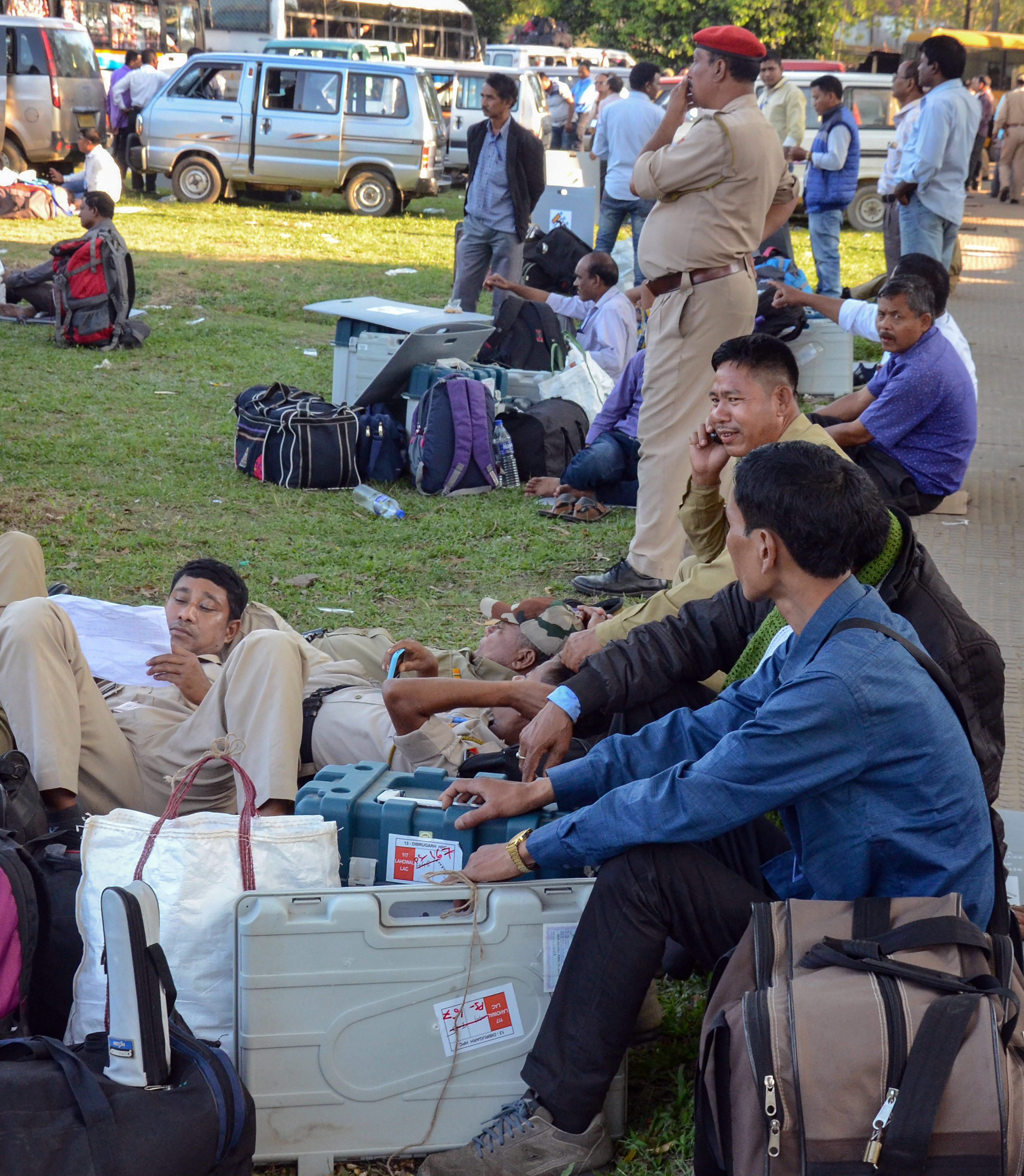 Police personnel rest after collecting their election duty slips and material at a distribution centre ahead of the Lok Sabha election in Dibrugarh on April 10.