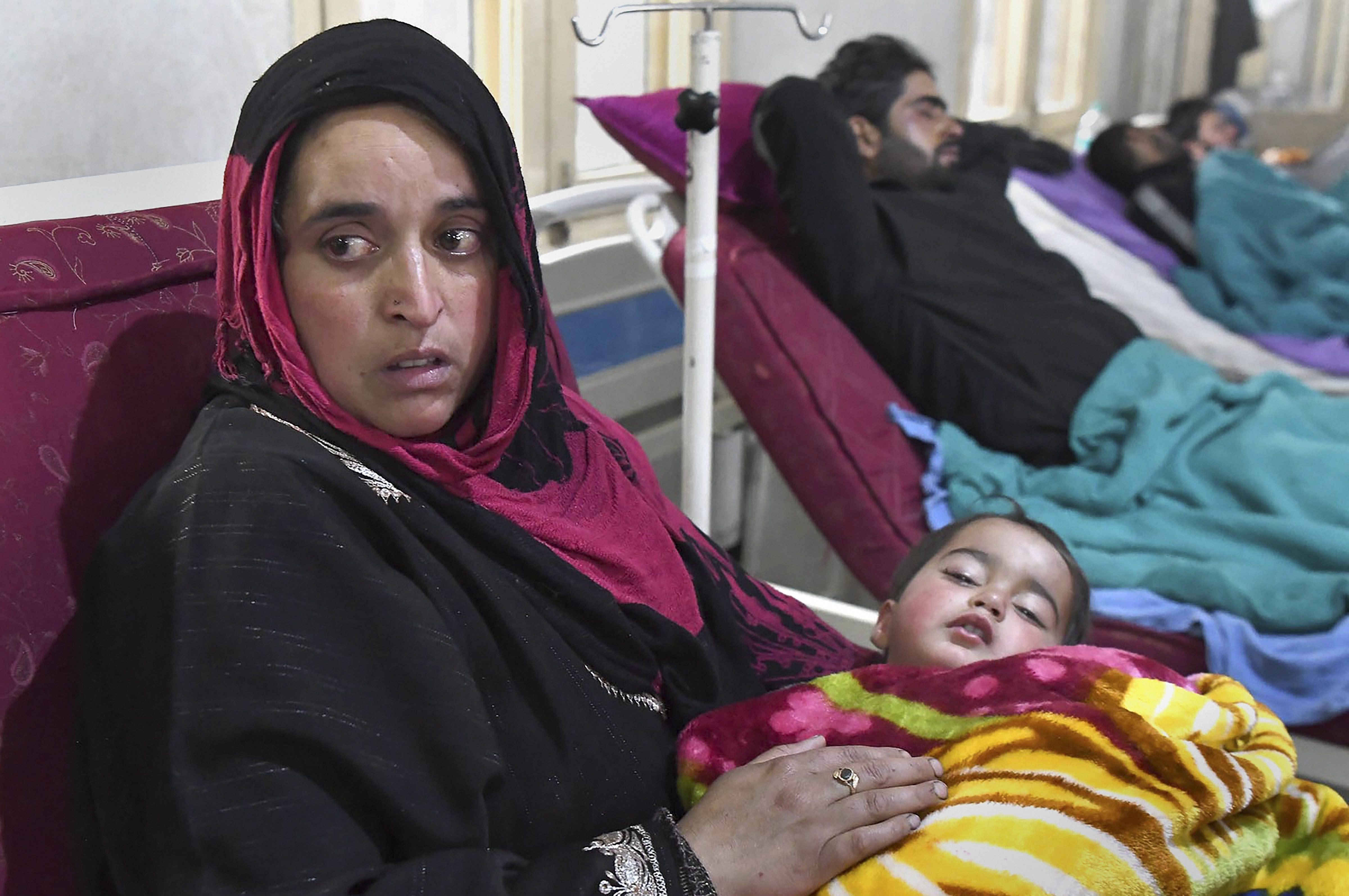 Hiba Nisar lies in her mother's arms at SMHS Hospital in Srinagar on Sunday.