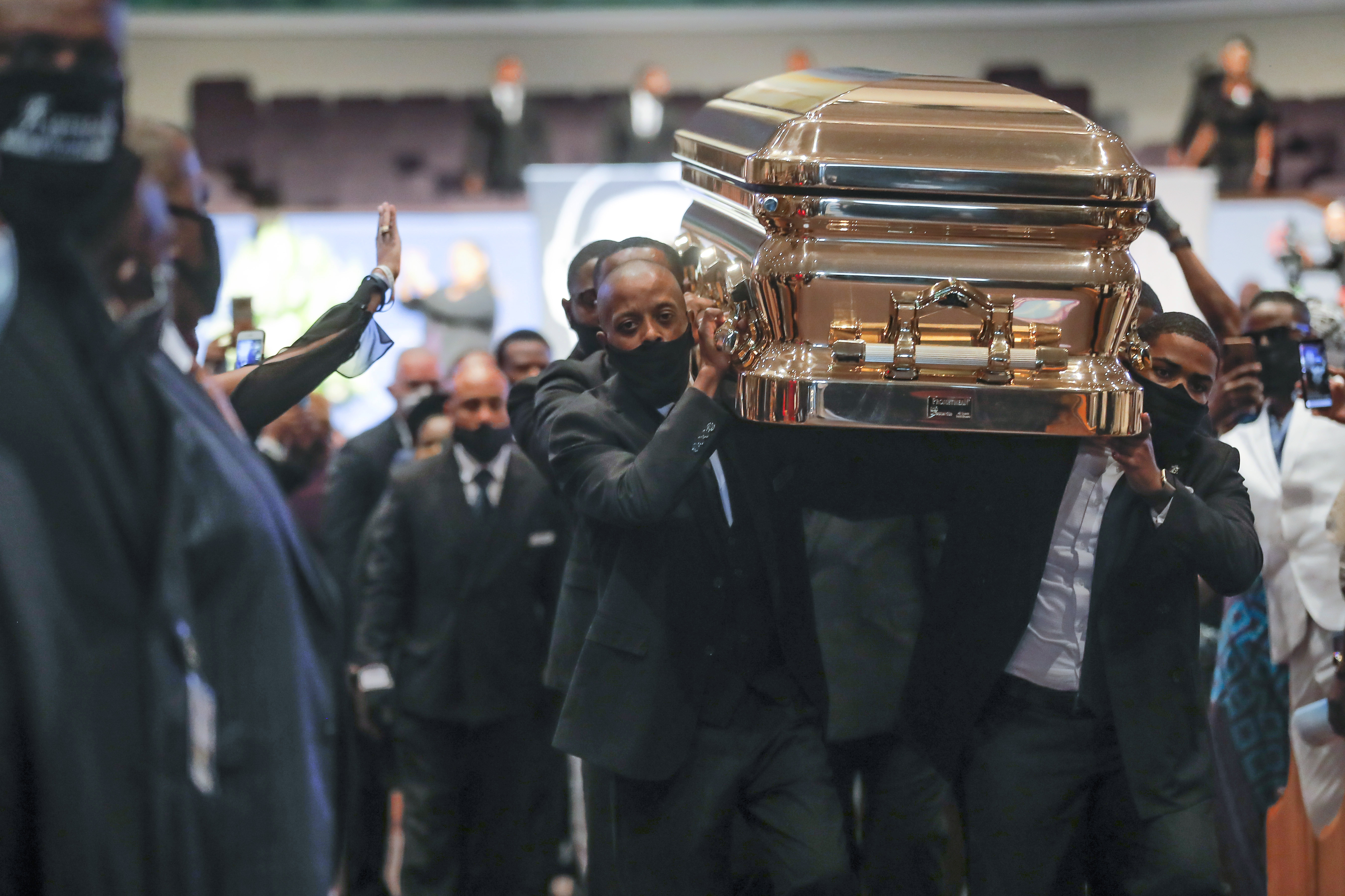 Pallbearers recess out of the church with the casket following the funeral for George Floyd on Tuesday