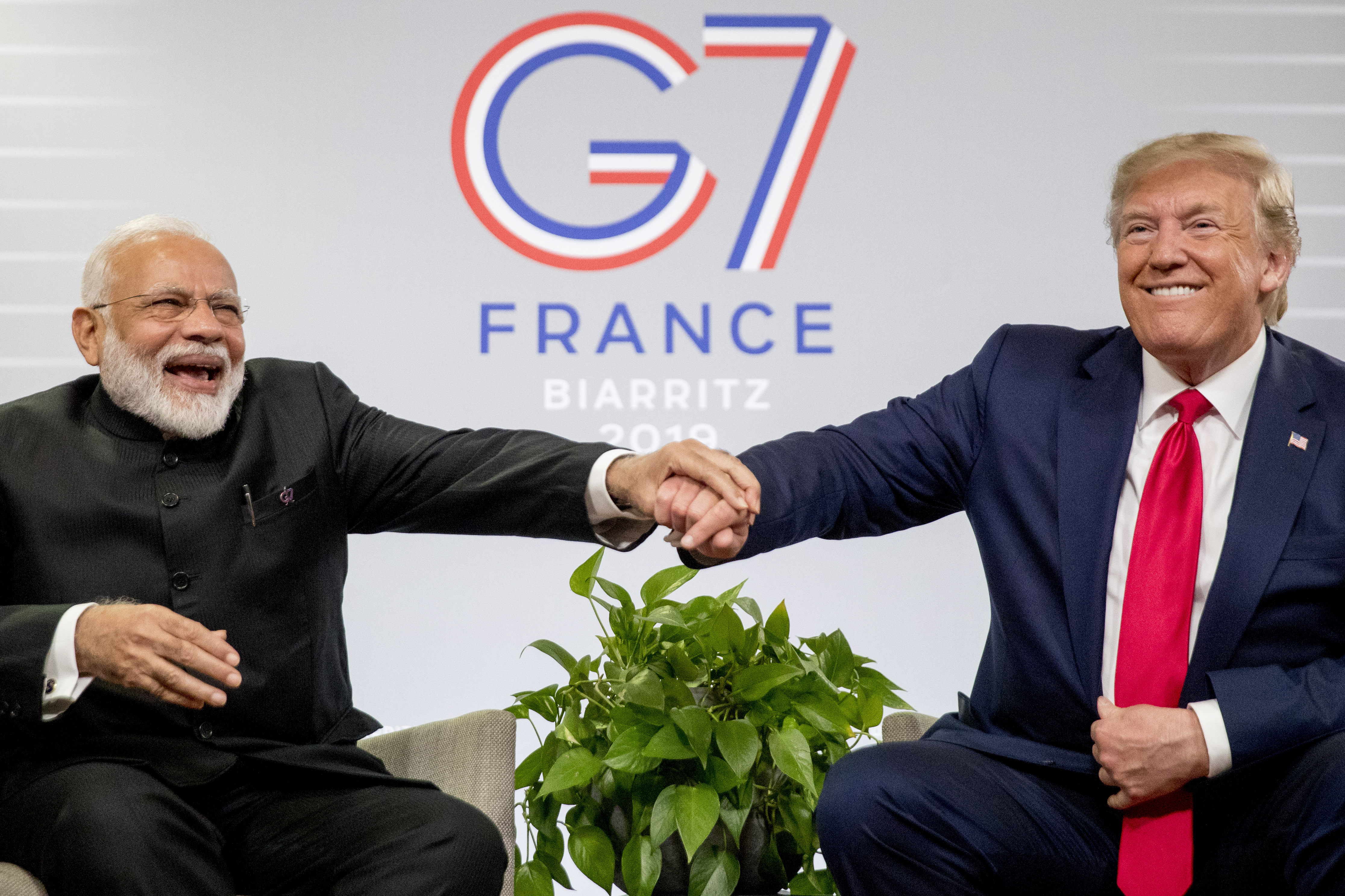 Modi and Trump share a laugh during a meeting at the G-7 summit in Biarritz, France, on August 26.