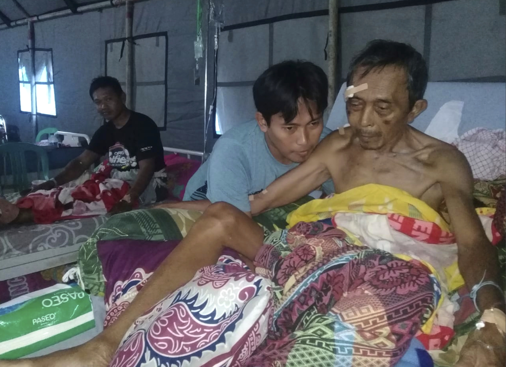 Earthquake-affected patients are treated at a makeshift hospital in Poso, Indonesia