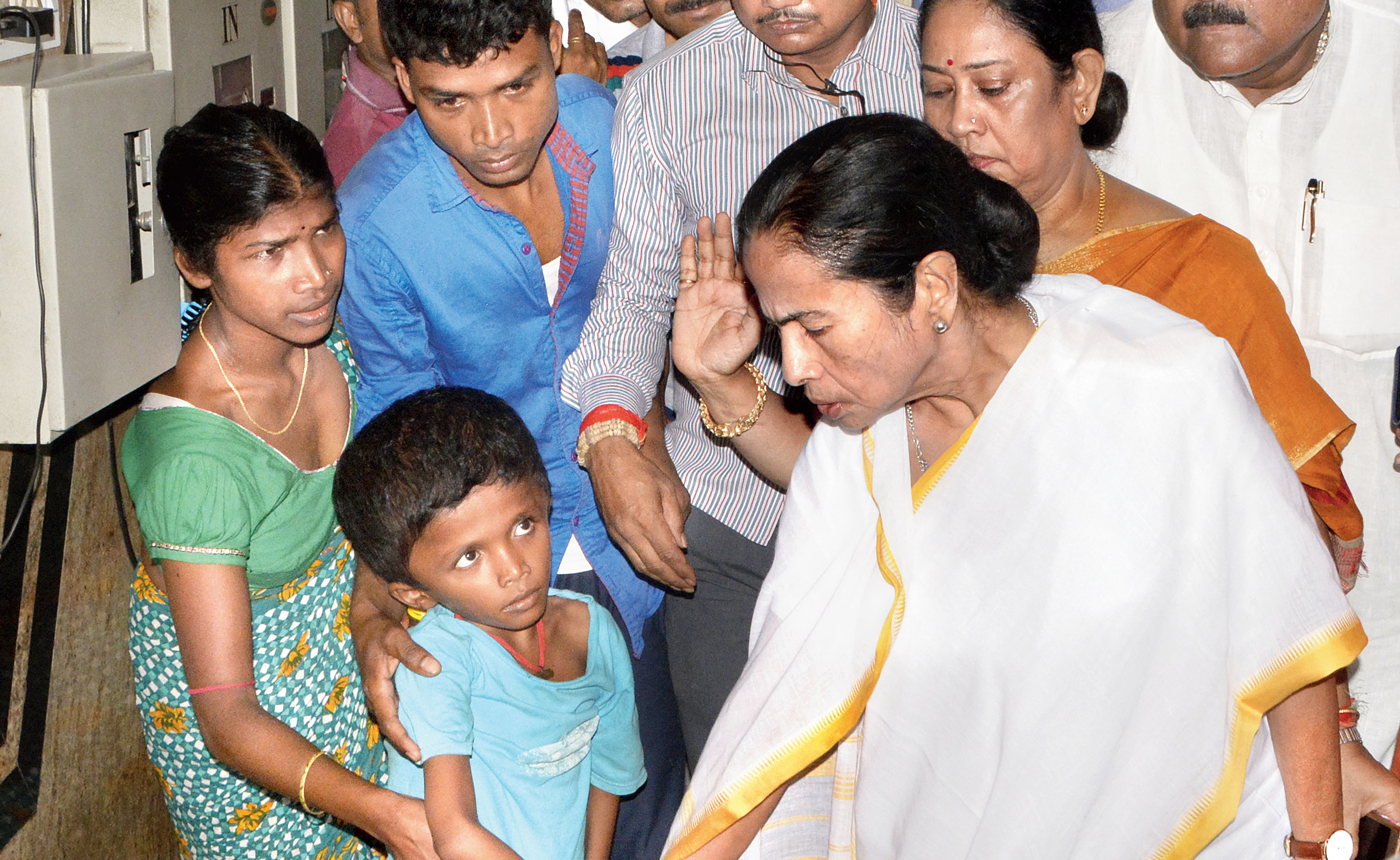 Chief minister Mamata Banerjee enquires about the condition of patients lying on the floor near the emergency ward at SSKM Hospital around noon on Thursday.