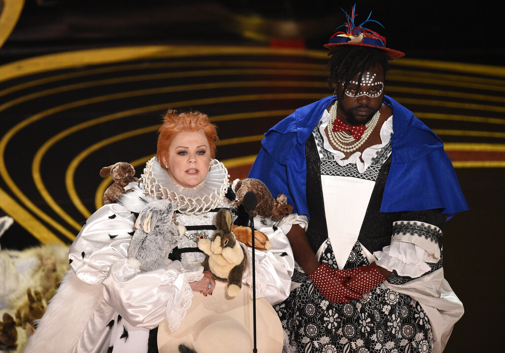 Melissa McCarthy, left, and Brian Tyree Henry present the award for best costume design.