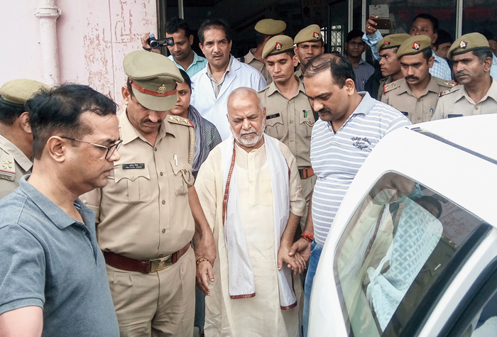 Chinmayanand outside a government hospital after the medical examination in Shahjahanpur on Friday.