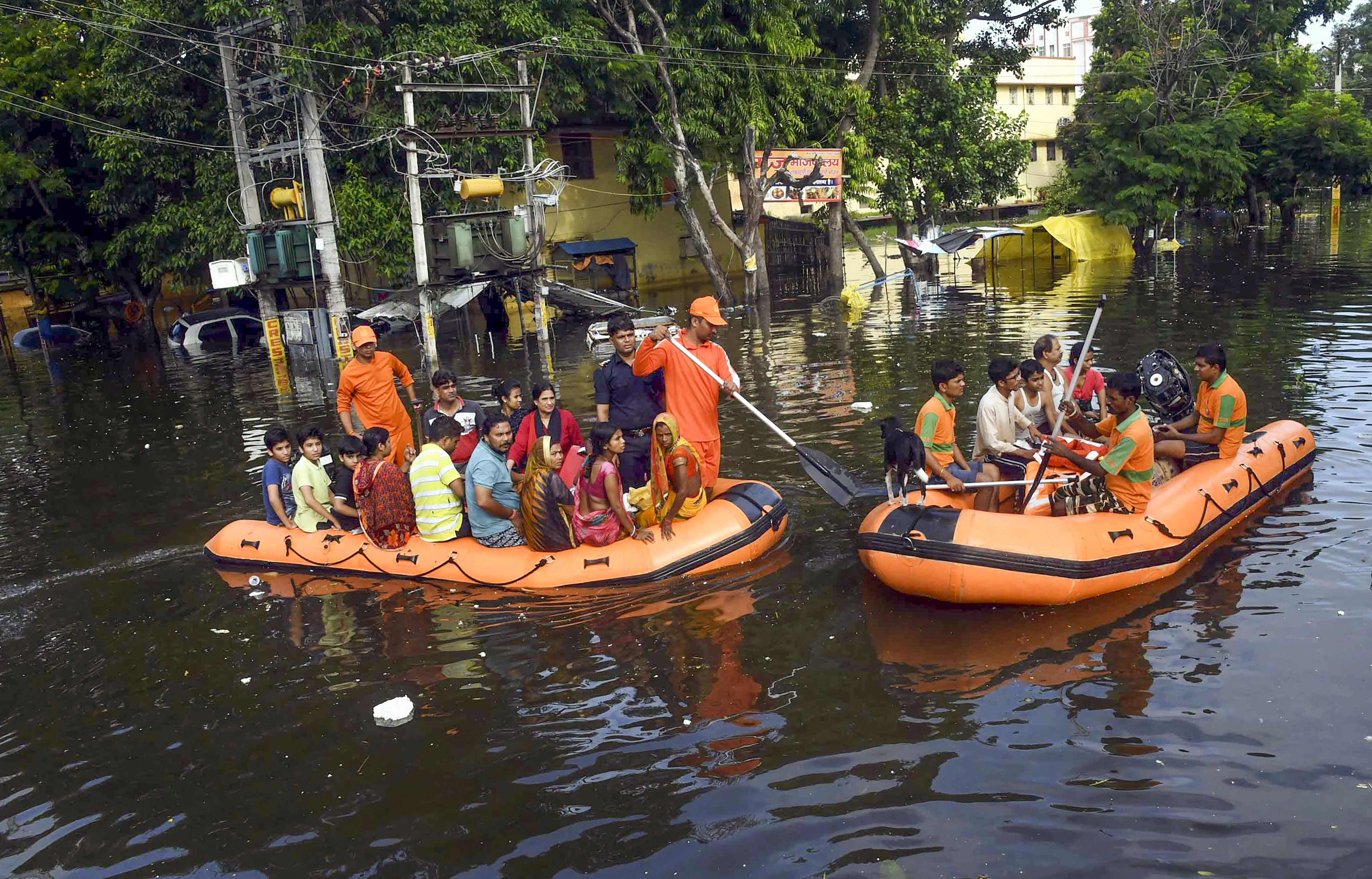 National and State Disaster Response Force personnel rescue people from flood-affected Rajendra Nagar area, in the aftermath of heavy rains in Patna, Wednesday, October 02, 2019.