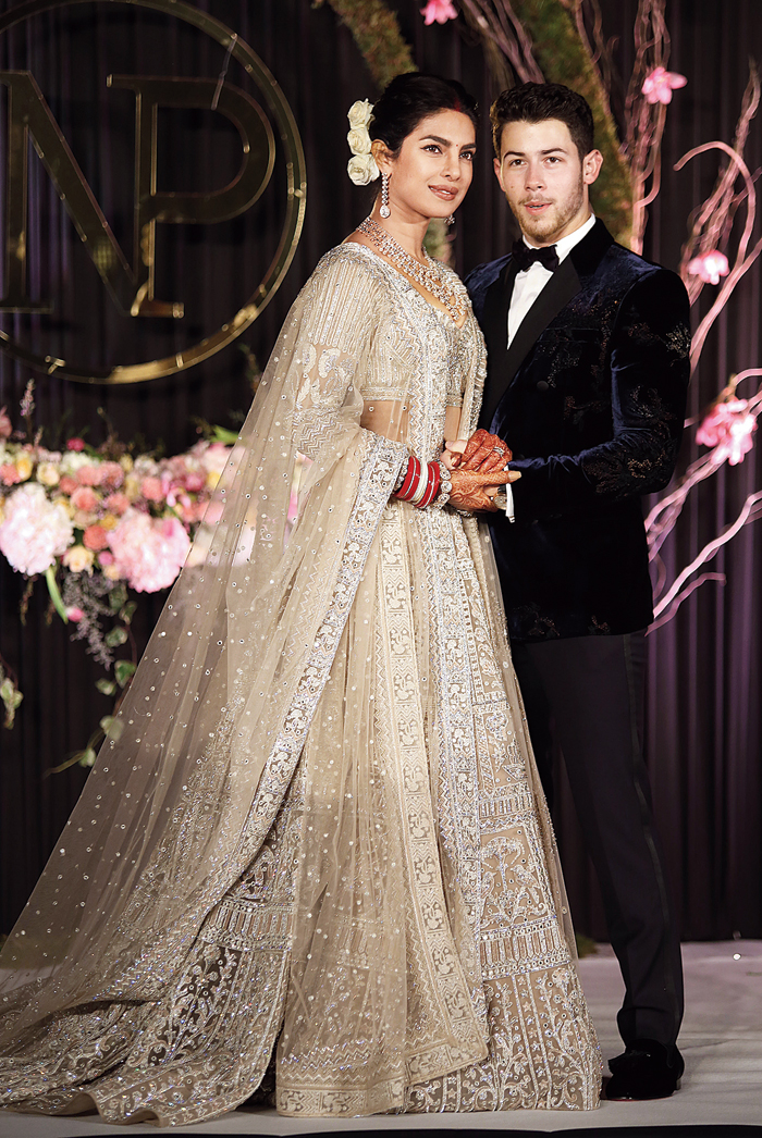 A simple bun with fresh flowers was what Priyanka Chopra chose for her wedding reception in Delhi. She wed Nick Jonas in 2018.