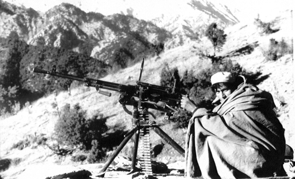 In this file photo taken on January 1, 1988, an Afghan rebel armed with an anti-aircraft machine gun gets ready to fire at position in the Nangarhar province of Afghanistan. As Russia prepares to mark Friday's anniversary of the Soviet withdrawal, many see the 10-year Soviet war in Afghanistan as a necessary and largely successful endeavour.