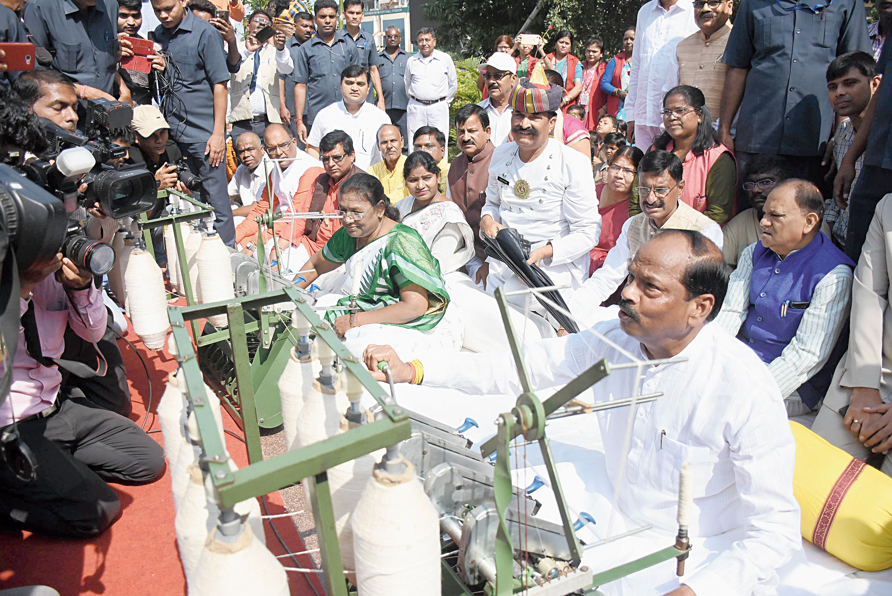 Governor Droupadi Murmu and CM Raghubar Das spin the charkha in Morabadi, Ranchi, on Wednesday.