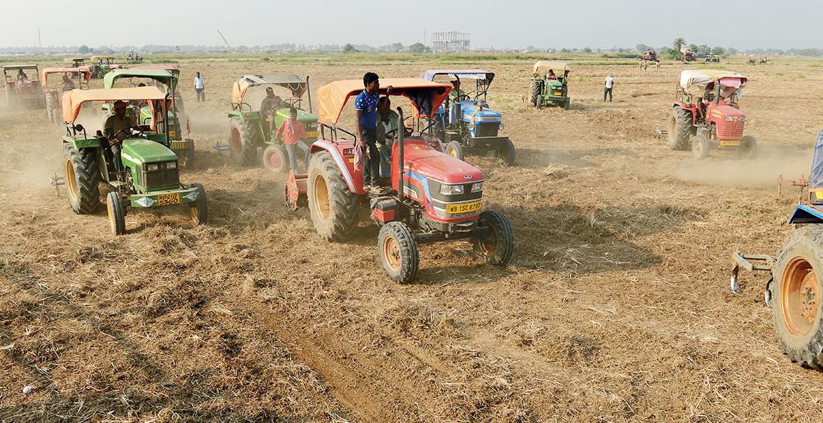 Tractors plying on Tata Motors factory land in Singur
