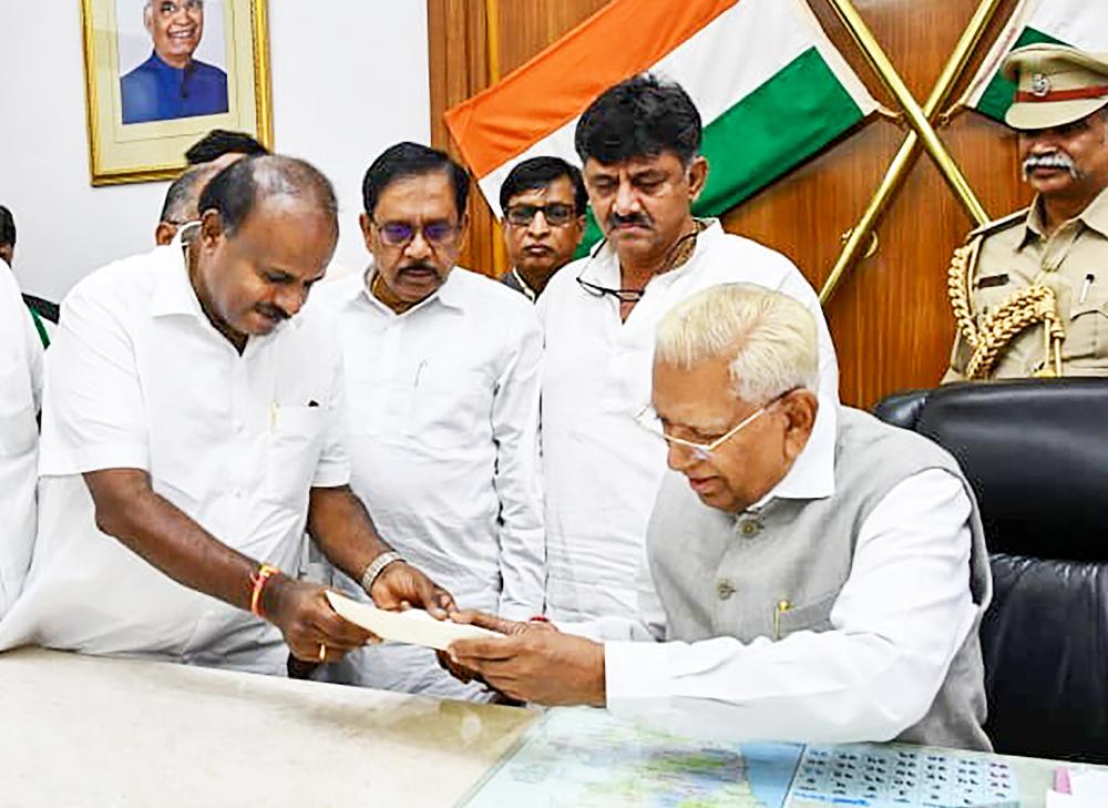 Karnataka Chief Minister H.D. Kumaraswamy submits his resignation to Karnataka Governor Vajubhai Vala after losing the vote of confidence, in Bangalore, Tuesday, July 23, 2019.