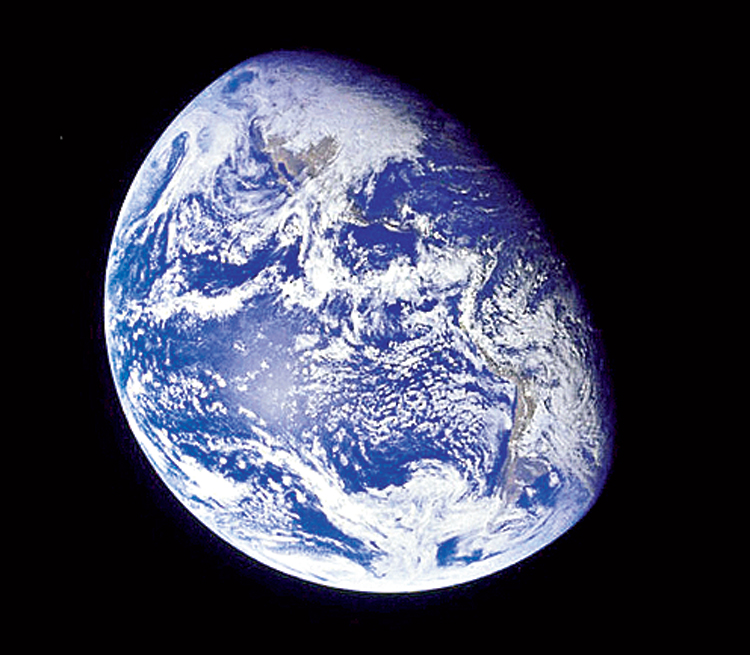 View of Earth as photographed by the Apollo 8 astronauts during their lunar orbit mission. The images from Apollo 8 created a new iconography, and gave man a sense of a new whole, a new ontology of the earth and its becoming, and a sense of man's being on it.