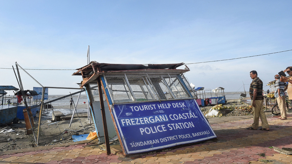 A policeman stands next to damaged Fraserganj Coastal Police Station along a beach in the aftermath of cyclone Bulbul, at Fraserganj, in South 24 Parganas district of West Bengal, Sunday, November 10, 2019.