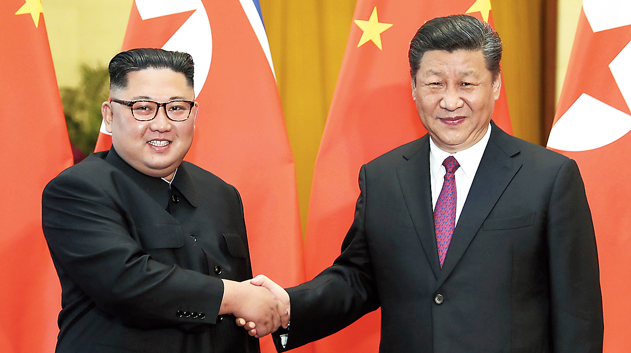 North Korean leader Kim Jong-un (left) and Chinese President Xi Jinping in Beijing on June 19, 2018.