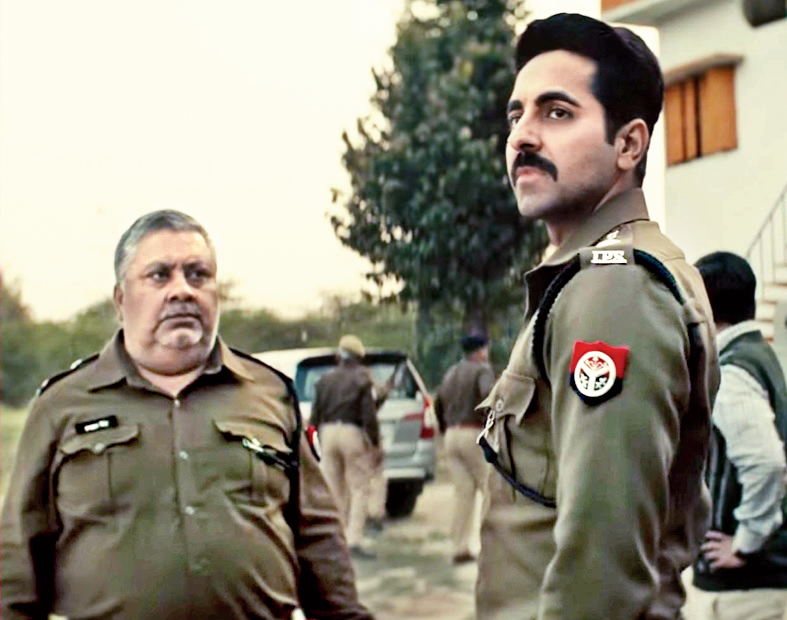 Ayushmann Khurrana with Manoj Pahwa in Article 15.