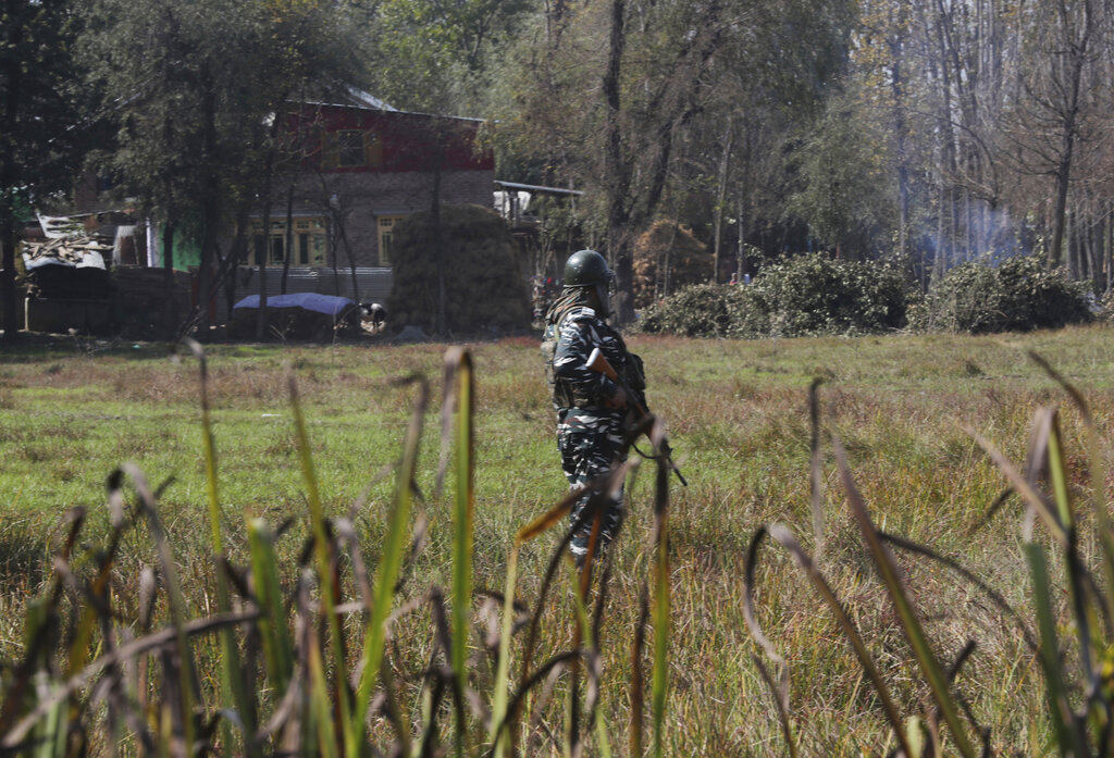 A paramilitary soldier stands guard near the site of a gunbattle in Bijbehara, south of Srinagar, on Wednesday, Oct. 16, 2019.