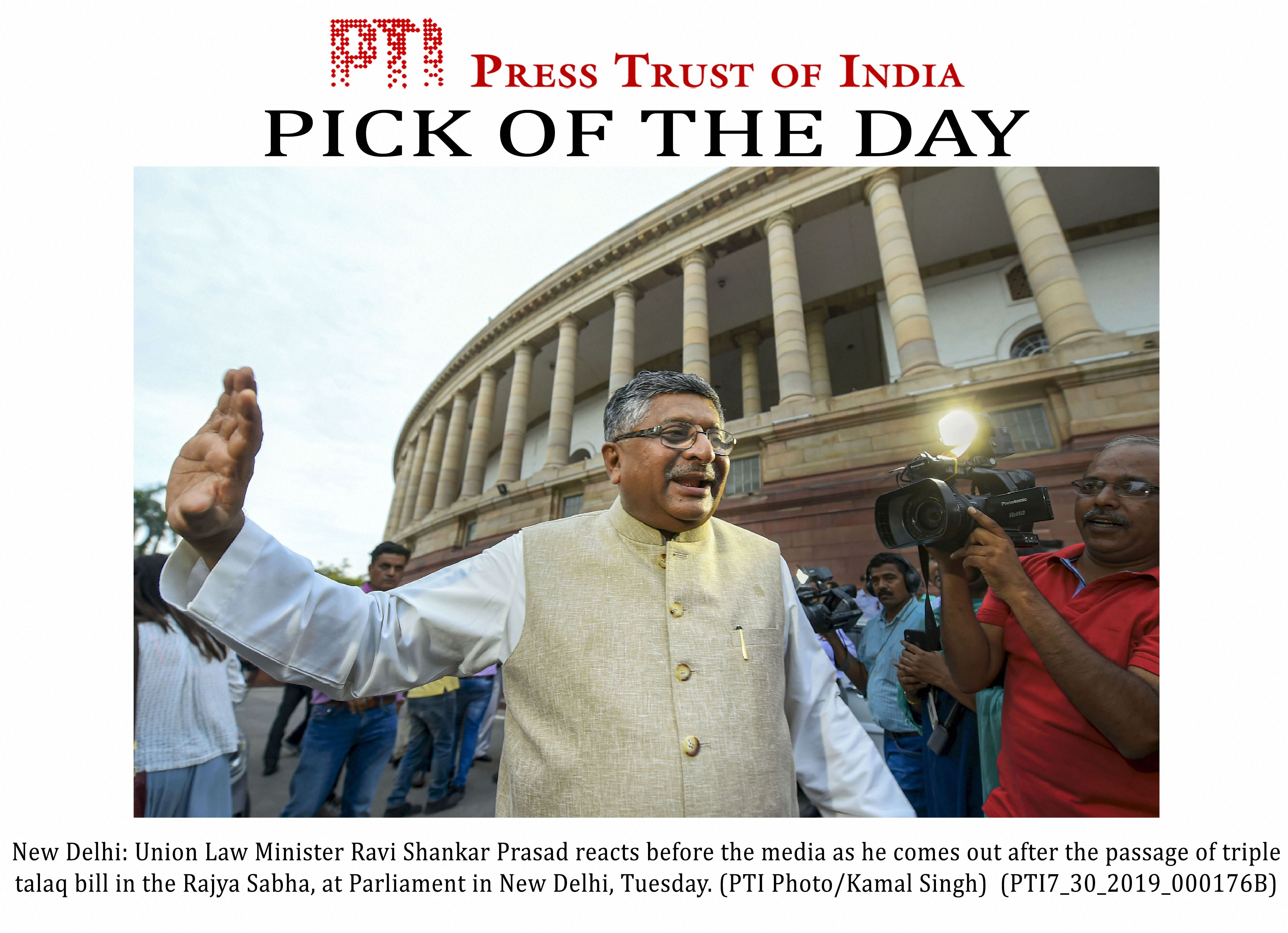 Union law minister Ravi Shankar Prasad reacts before the media as he comes out after the passage of instant triple talaq bill in the Rajya Sabha on Tuesday.