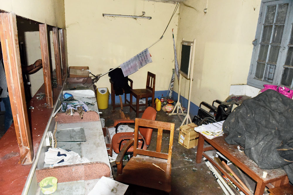Another portion of the smashed college office.