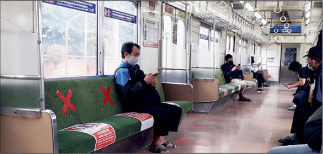 Commuters practice social distancing on trains in Jakarta