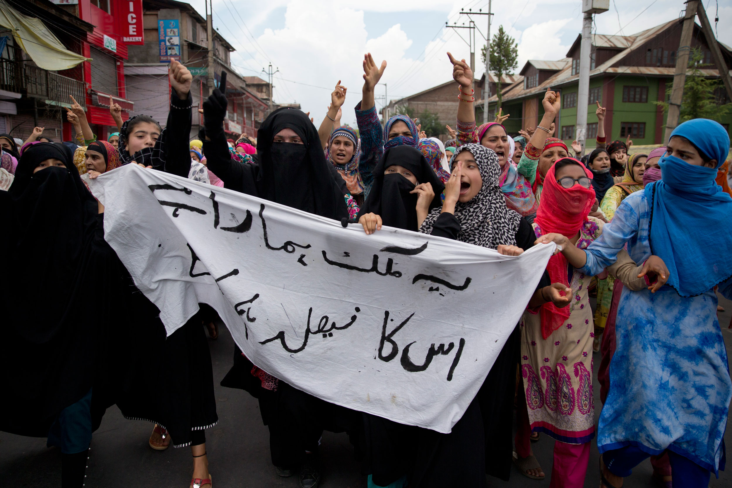 Kashmiri women participate in a protest march in Srinagar