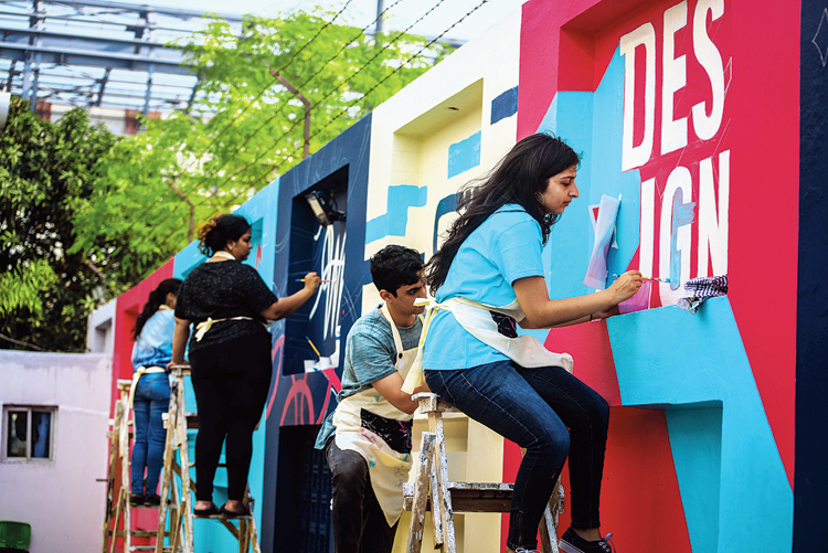 Students from the Mumbai campus of Ecole Intuit Lab paint a mural in Topsia. The words they painted are 'Who said design left Kolkata?' More such murals are planned in the city's public spaces.