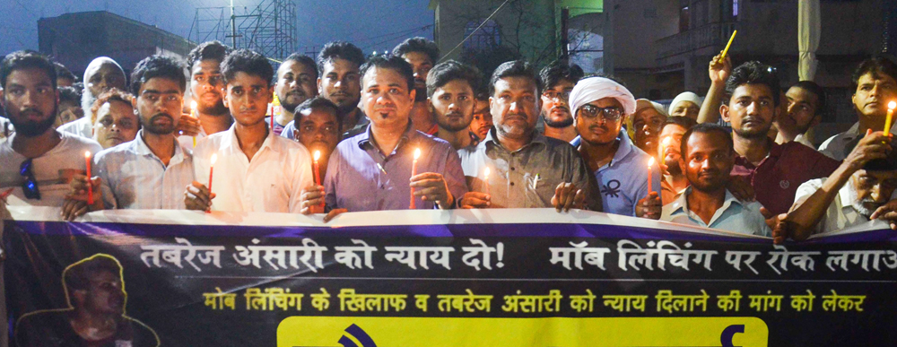 People participate in a candle light march demanding justice for the death of Tabrez Ansari who died due to mob lynching in Jharkhand, in Muzaffarpur, Saturday, June 29, 2019.