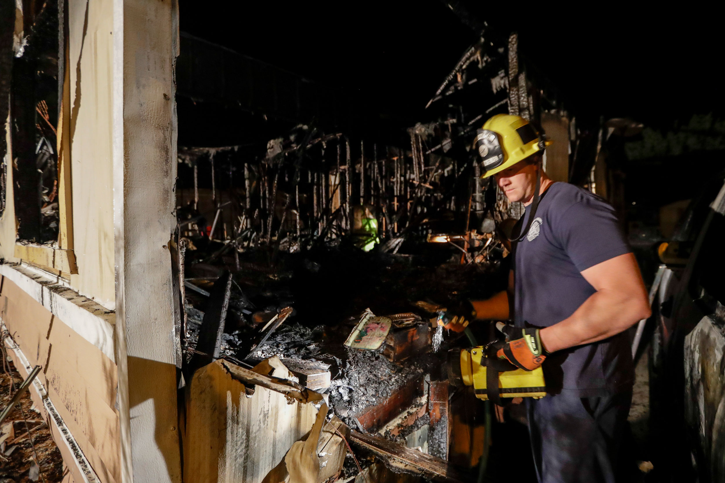 A fireman looks over a home that burned after an earthquake in Ridgecrest, California, Saturday, July 6, 2019.