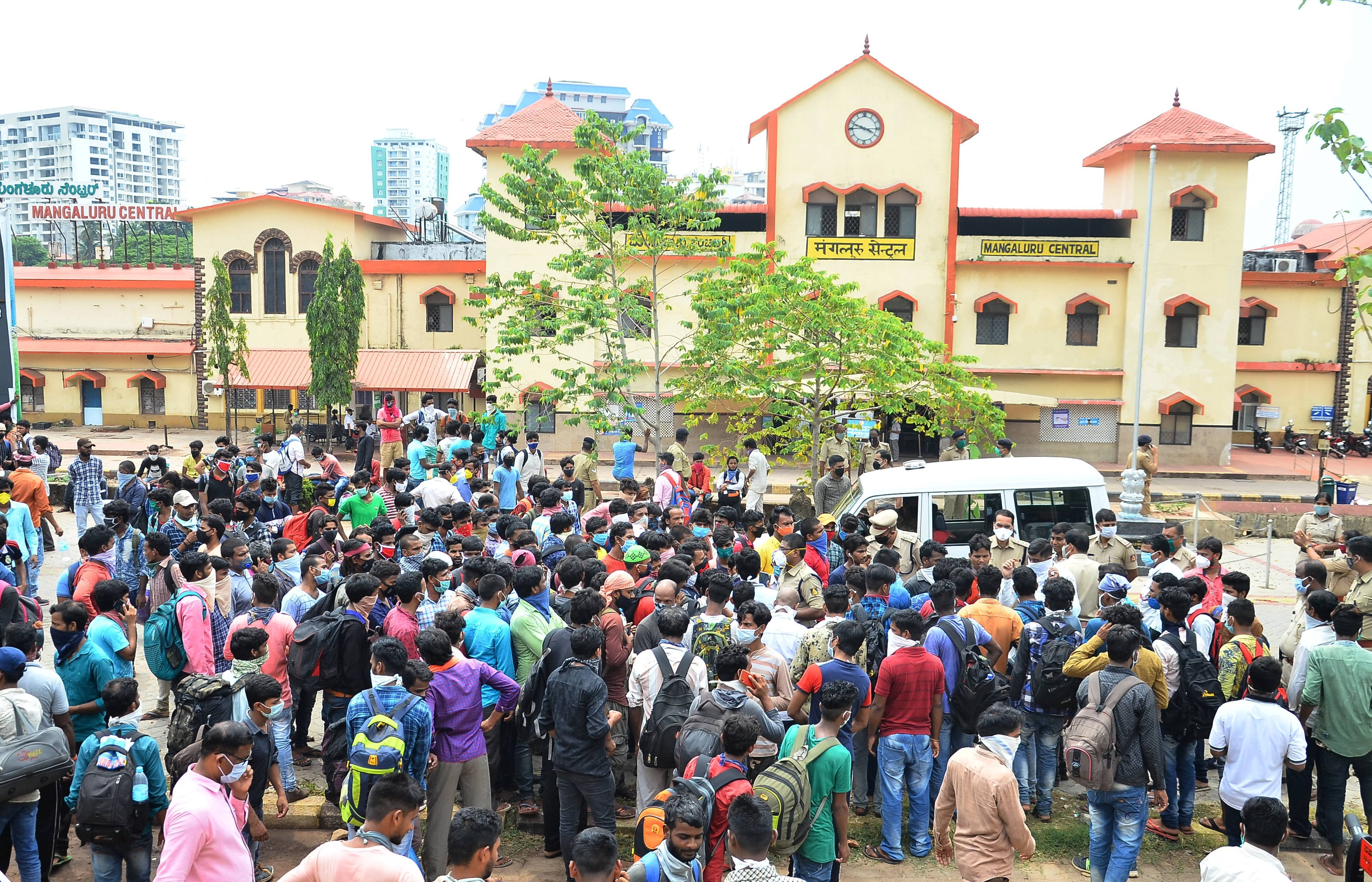 Migrant workers from Jharkhand gather near the Mangalore Central Railway Station