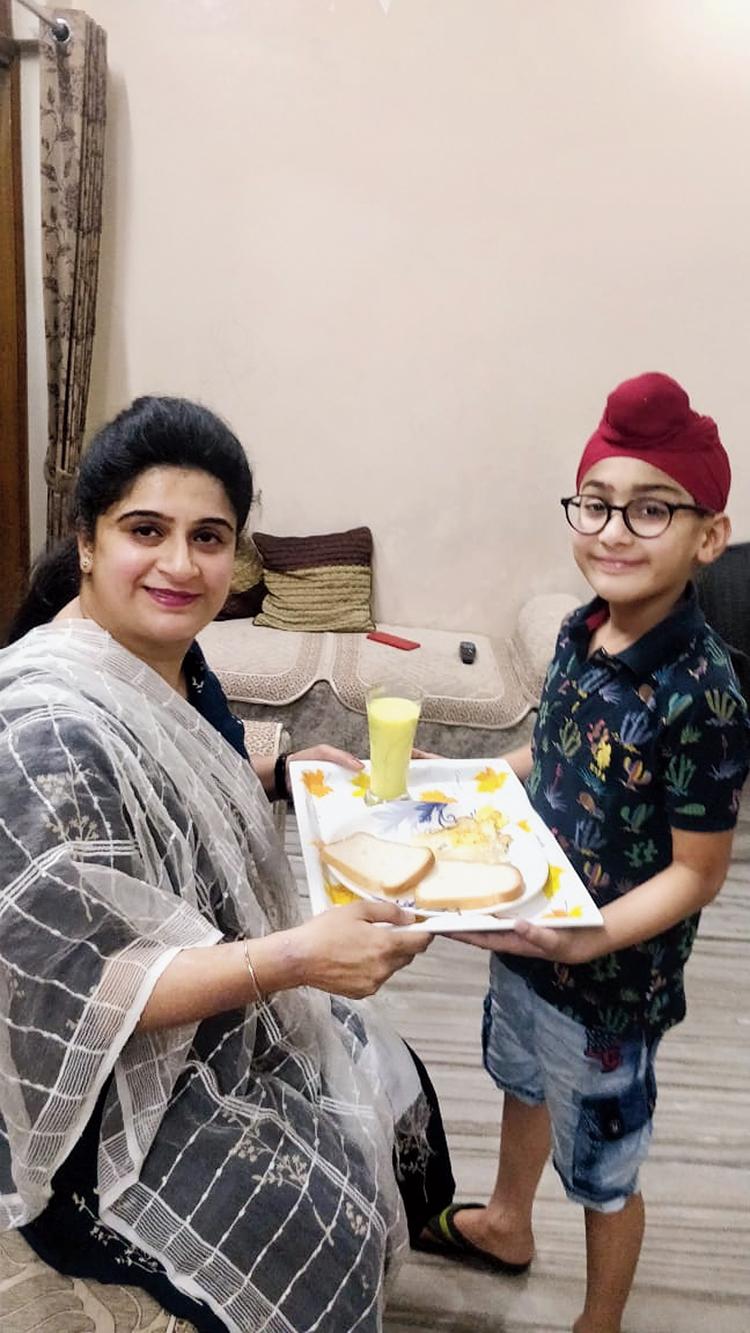 Rajvansh hands over his special breakfast to mother Manmeet Bhatia in Jamshedpur on Sunday.