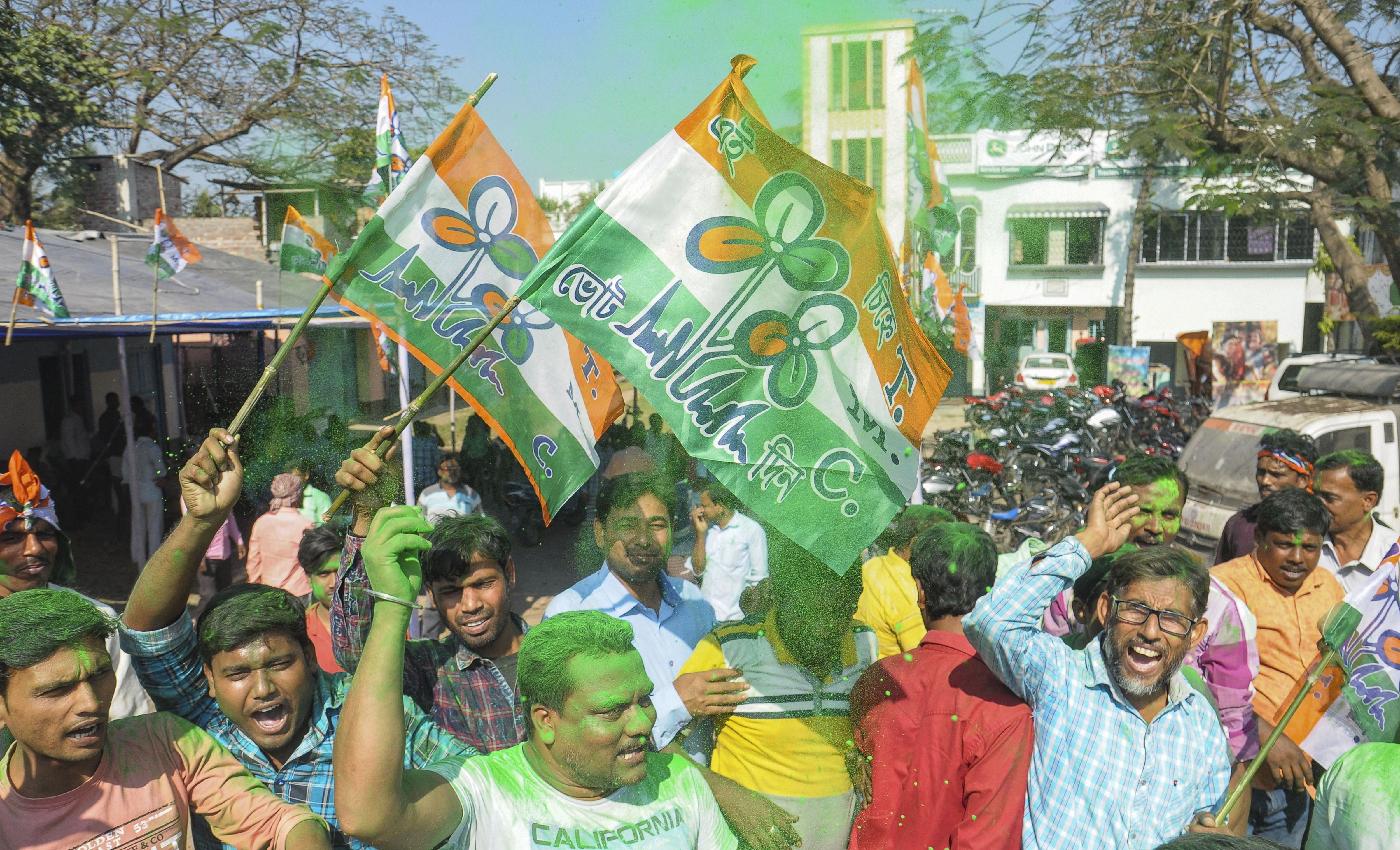 Trinamul Congress supporters celebrate after party's victory in the Karimpur Assembly seat bypoll, in Nadia, Thursday, November 28, 2019.