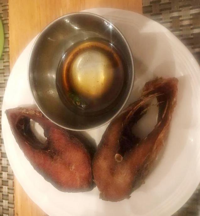 The small restaurants on the Sonamura border serve ilish from Bangladesh