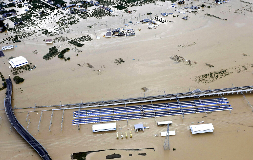 Rows of bullet trains, parked in a facility, sit in a pool of water in Nagano, central Japan, after Typhoon Hagibis hit the city, Sunday, October 13, 2019