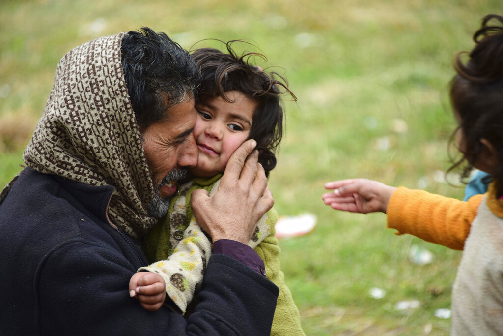 A man, who had to flee his hometown in Kashmir after shelling on the border, hugs his crying daughter. As grenades burst, blood flows and Kashmiris are beaten up, India needs popular sanction for its policies.