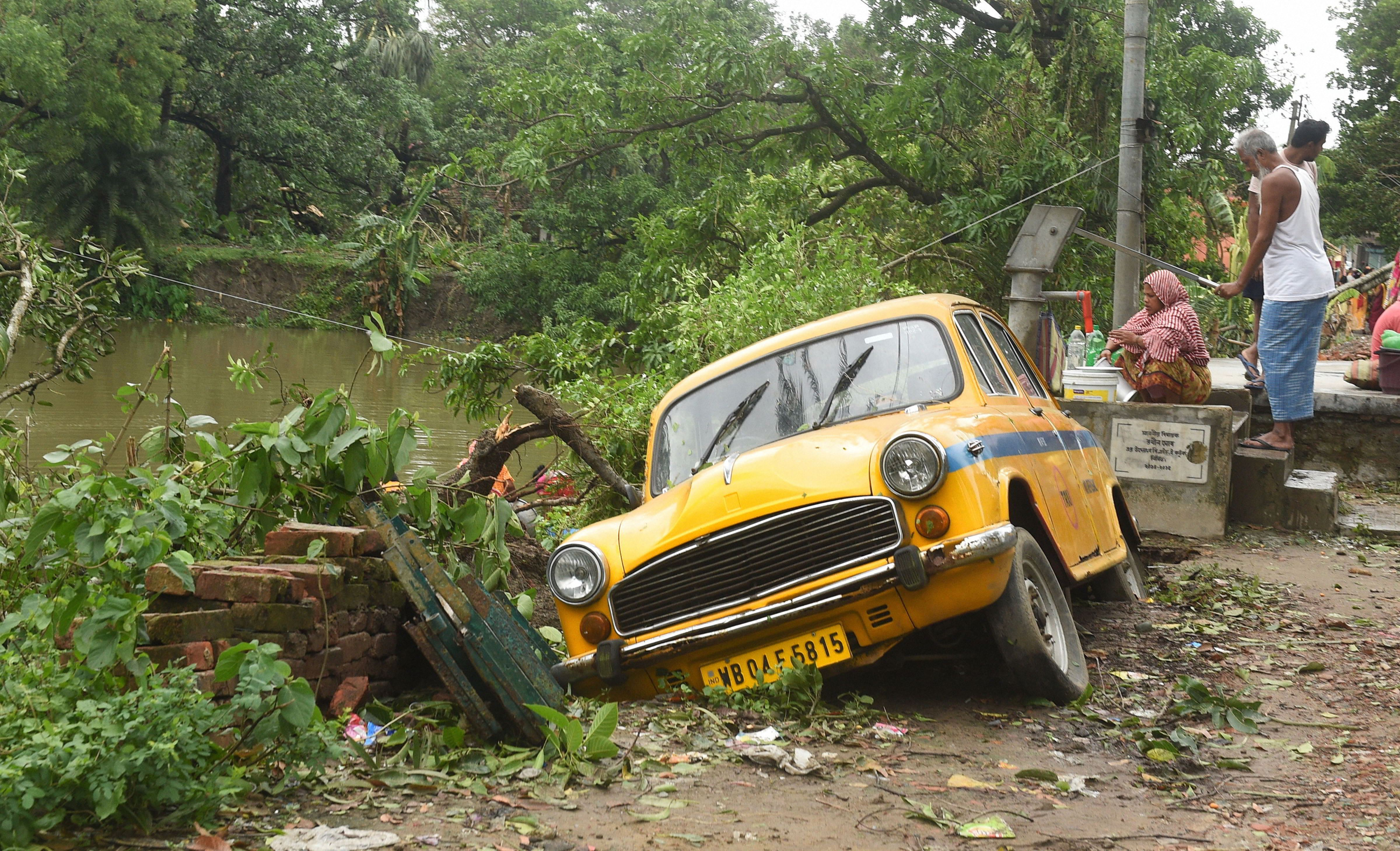A taxi damaged during cyclone Amphan, in North 24 Parganas, Thursday, May 21, 2020