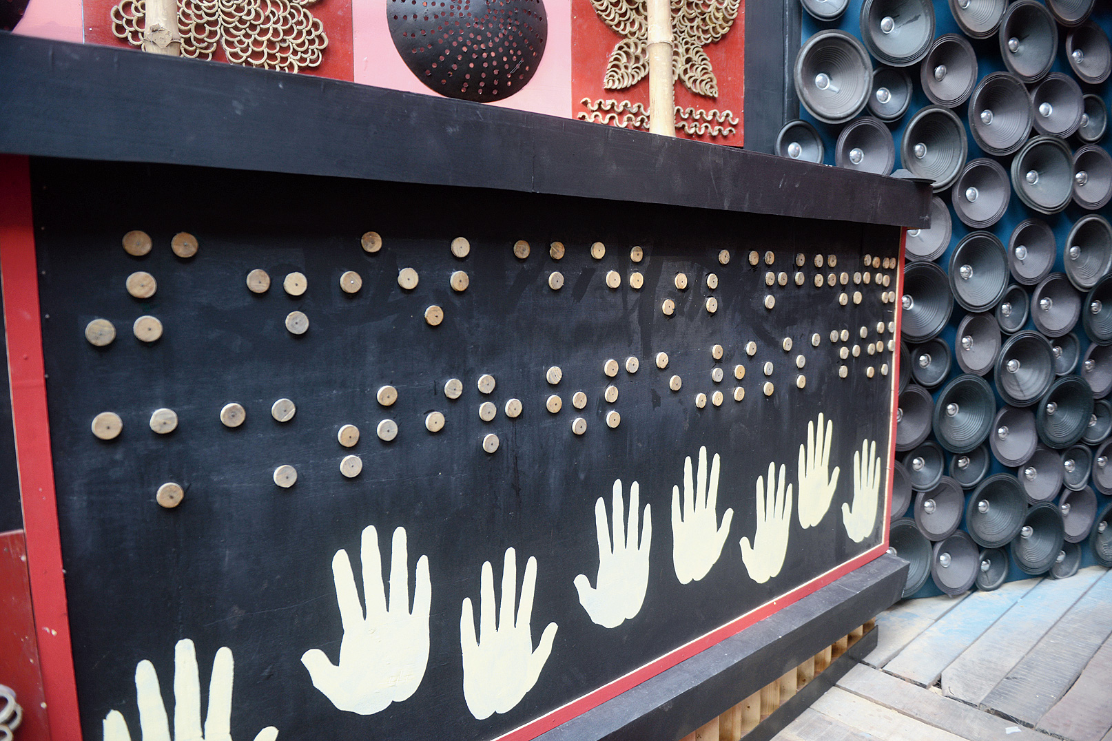 A part of the Durga mantra written in Braille on one of the walls of the pandal.