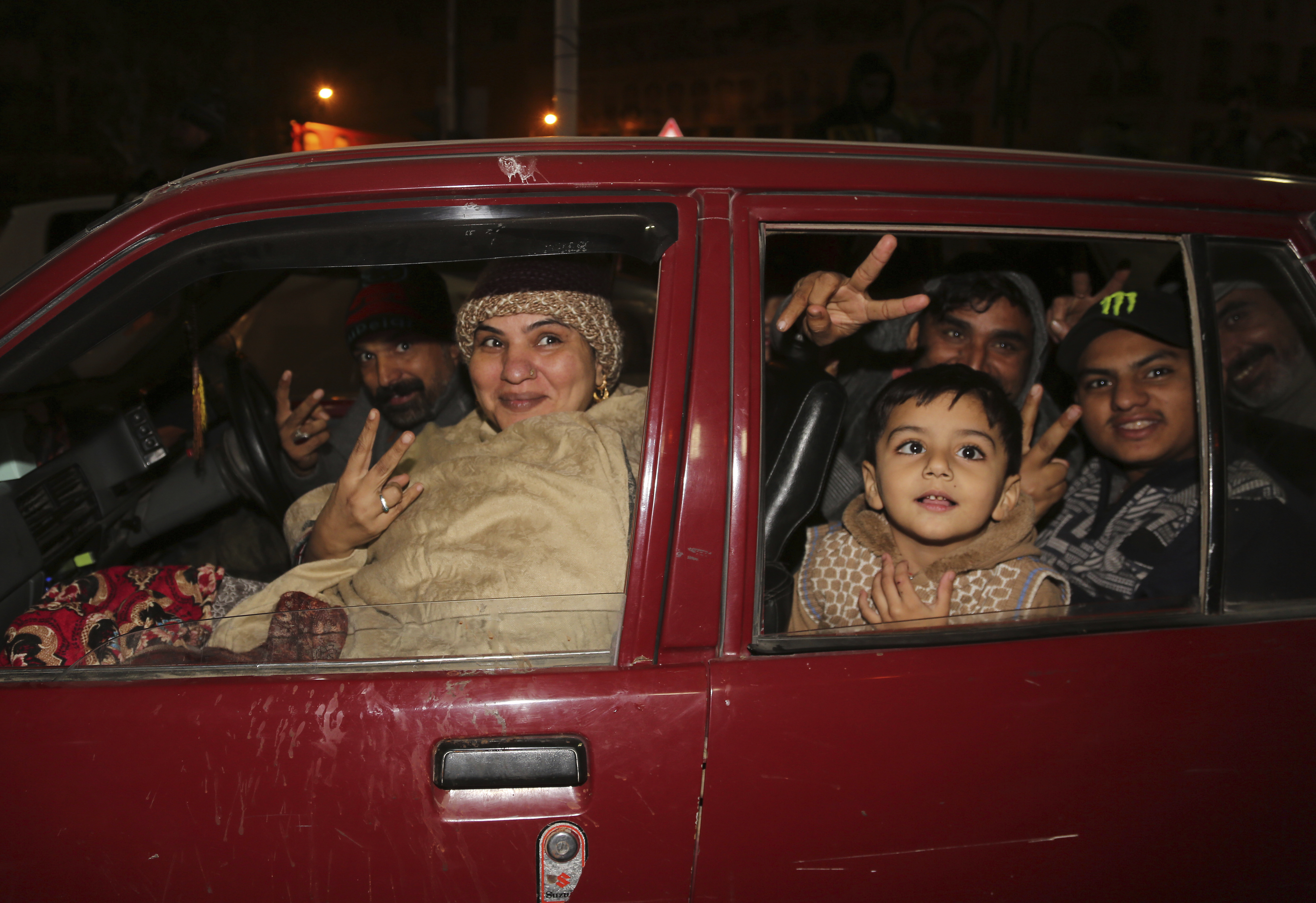 Pakistan family celebrate the New Year in downtown of Lahore, Pakistan, Wednesday, January 1, 2020.