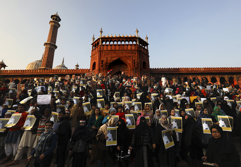 People hold placards during a protest against new citizenship law at Jama Masjid, in New Delhi, on Thursday