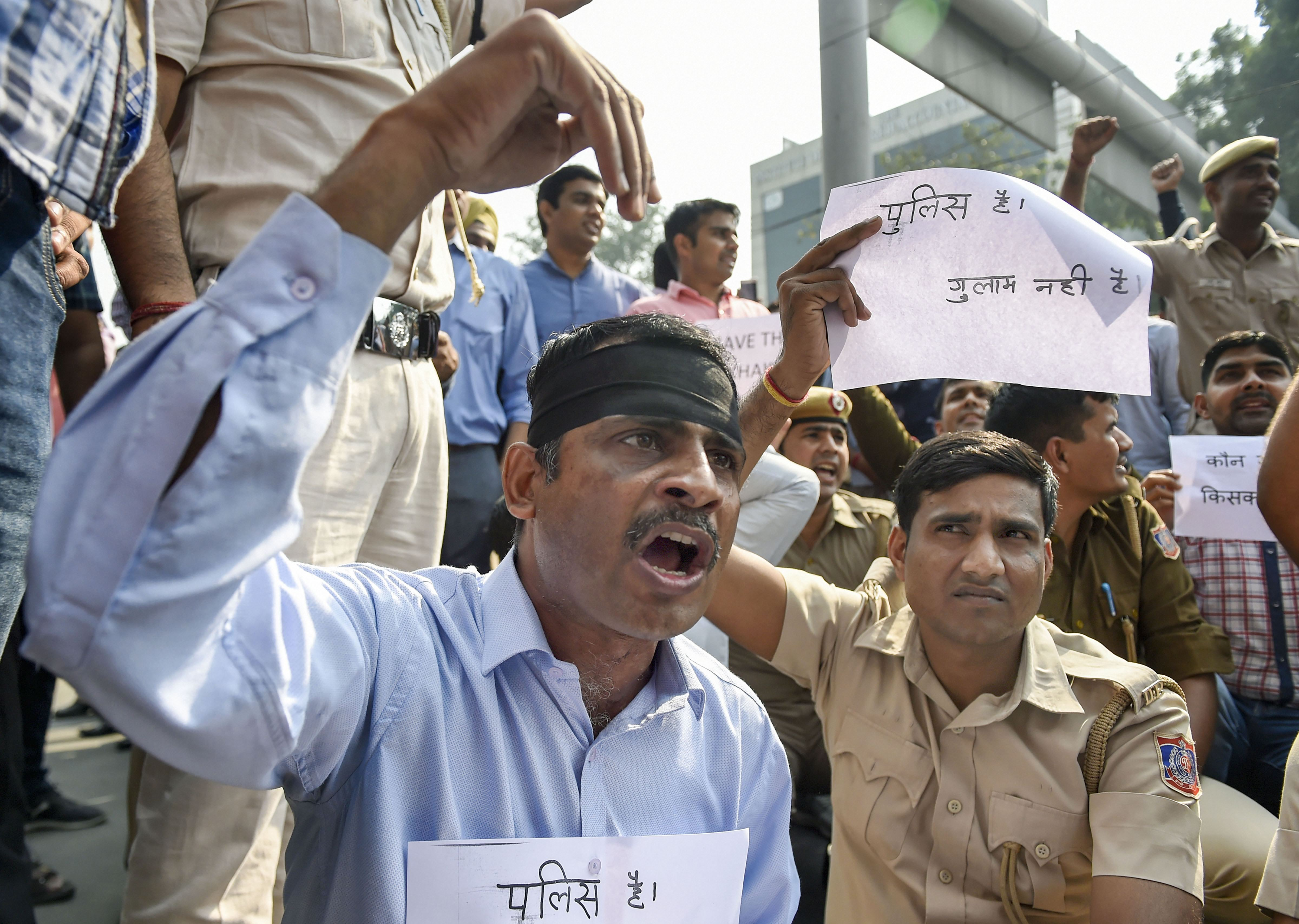 Police personnel stage a protest over the assault on policemen following clashes with lawyers at Tis Hazari court and Saket court, at police headquarters in New Delhi, Tuesday, November 5, 2019.