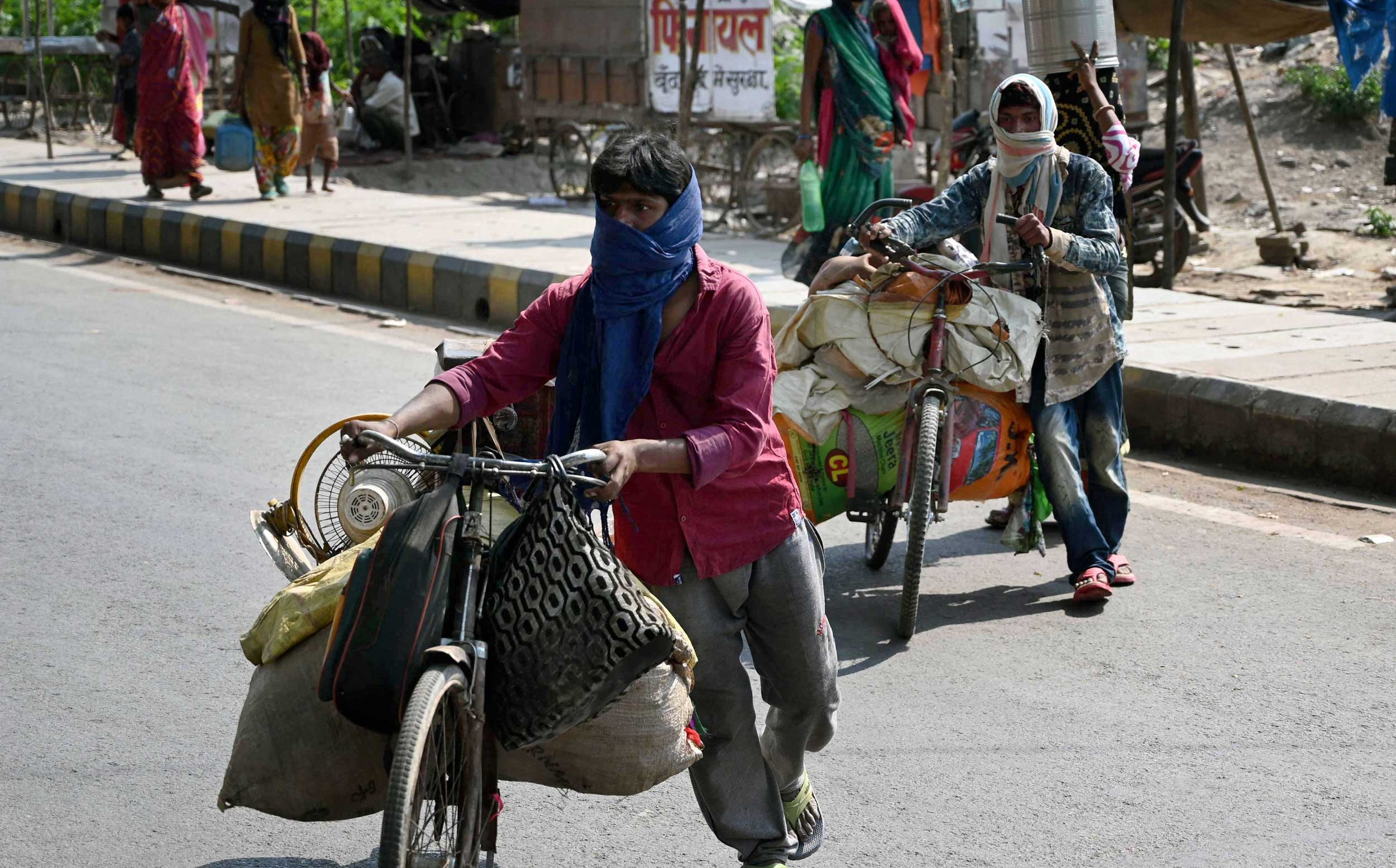 Migrant workers on their way back home in Allahabad on Saturday.