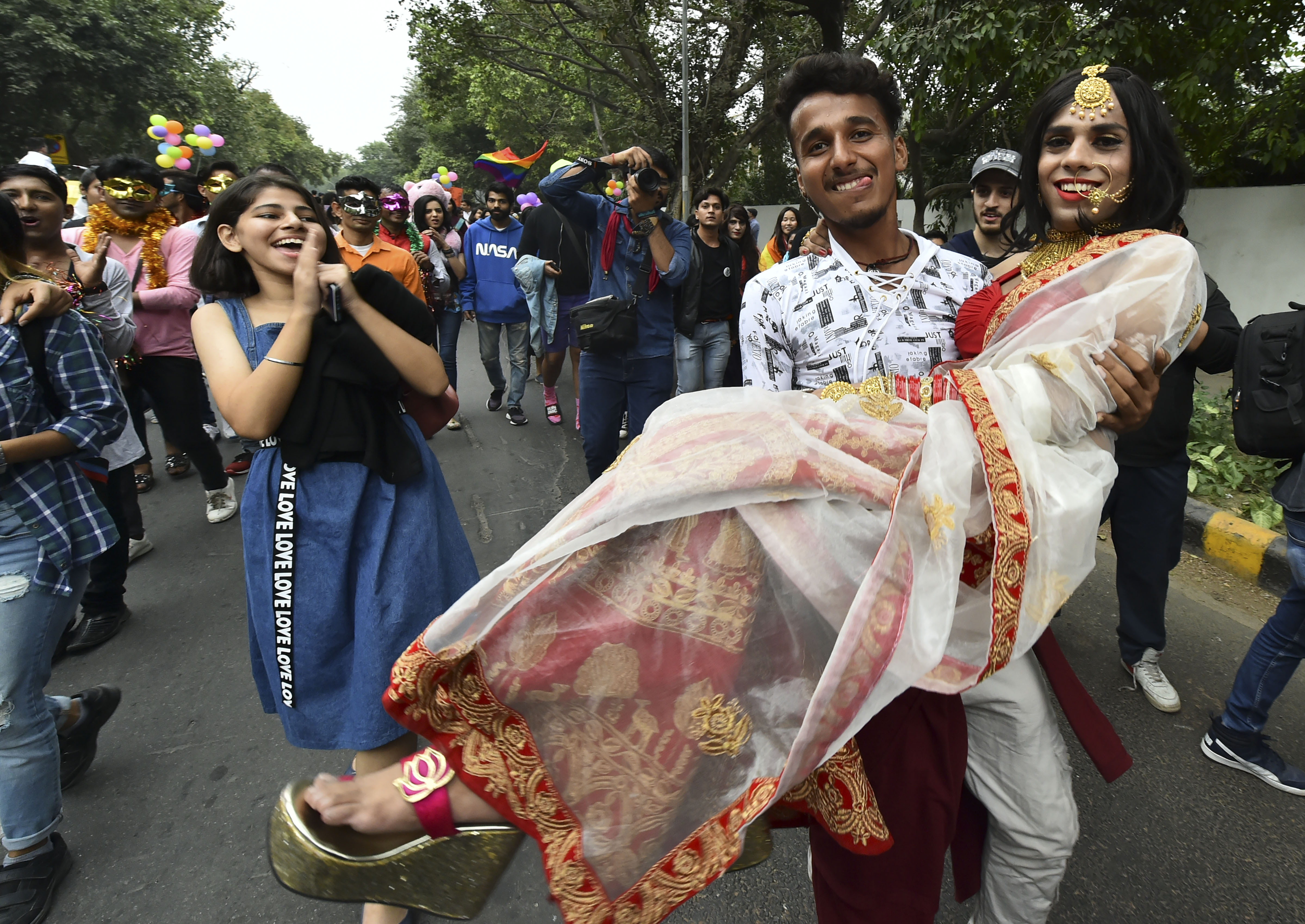 Members of the LGBTQ community and their supporters march during the annual Delhi Queer Pride Parade in New Delhi on Sunday, November 24, 2019.