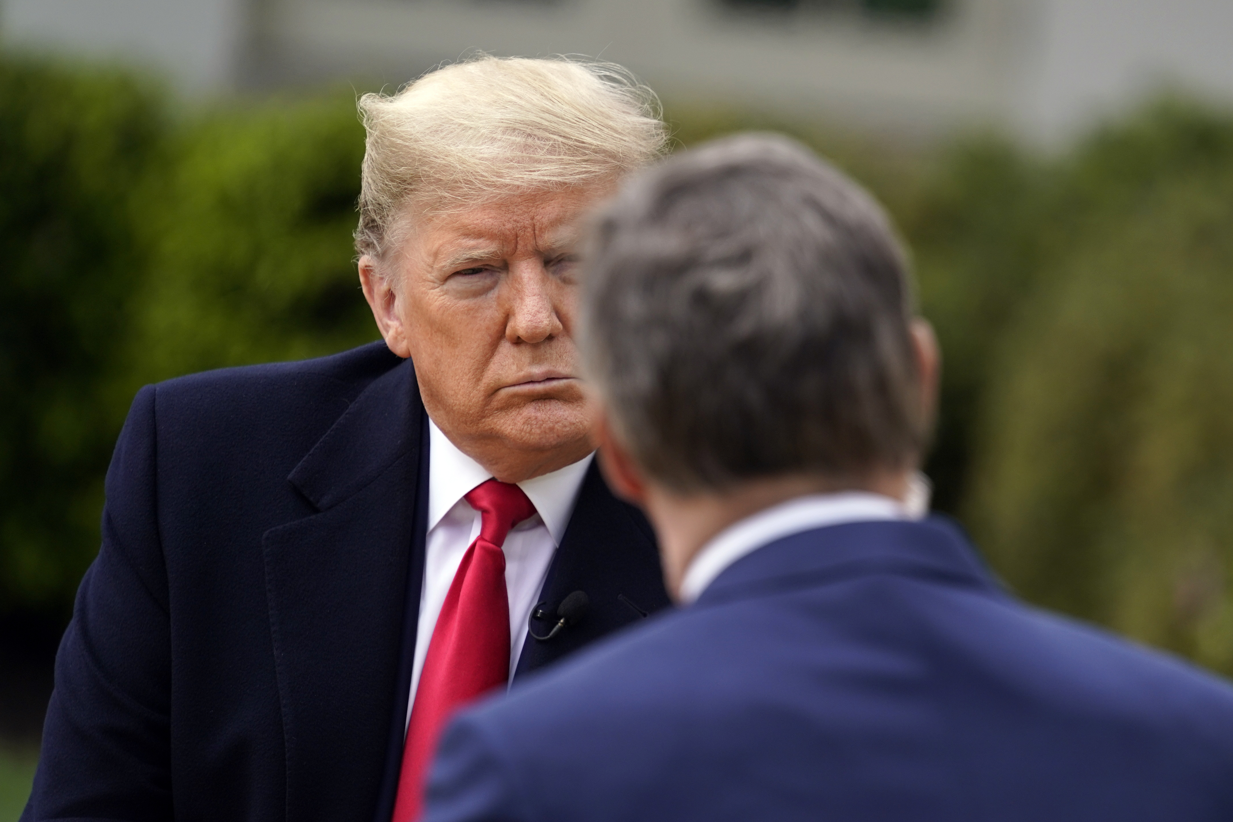 President Donald Trump speaks with Fox News Channel Anchor Bill Hemmer during a Fox News Channel virtual town hall, at the White House on Tuesday