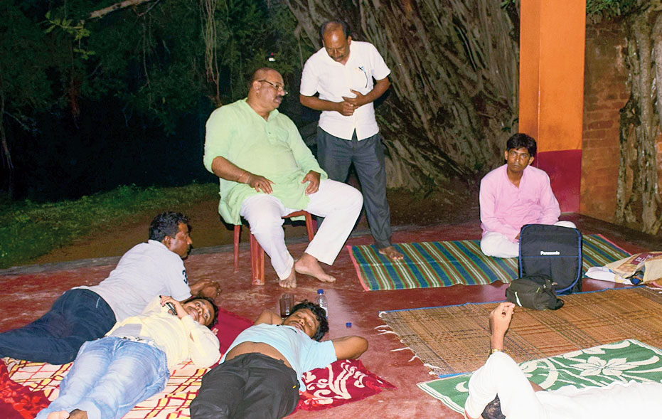 The minister and aides spend the night at a village temple.