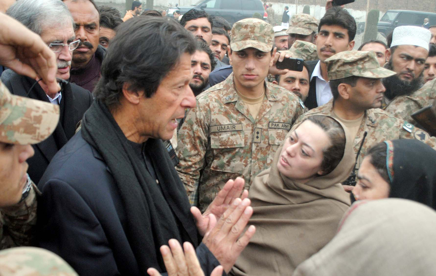 Imran Khan consoles the parents of students who were killed in a Taliban attack on an Army Public School on December 22, 2014 in Peshawar.