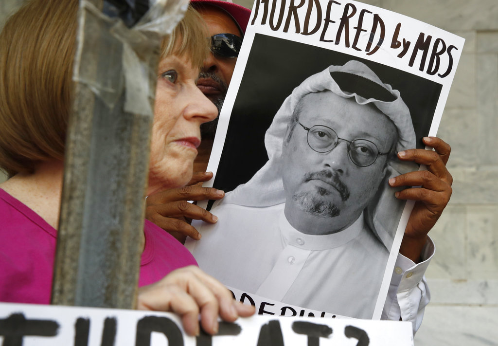 A woman holds a sign during a protest at the embassy of Saudi Arabia in Washington in October.