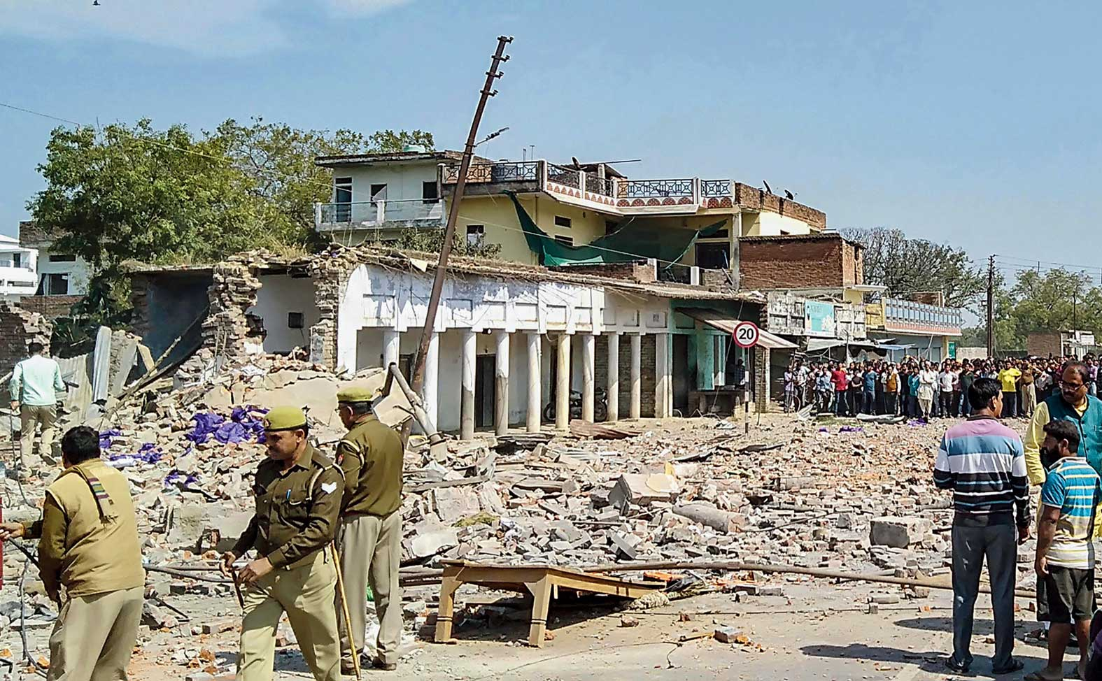 Police inspect the site of the explosion at Bhadohi in Uttar Pradesh on Saturday.