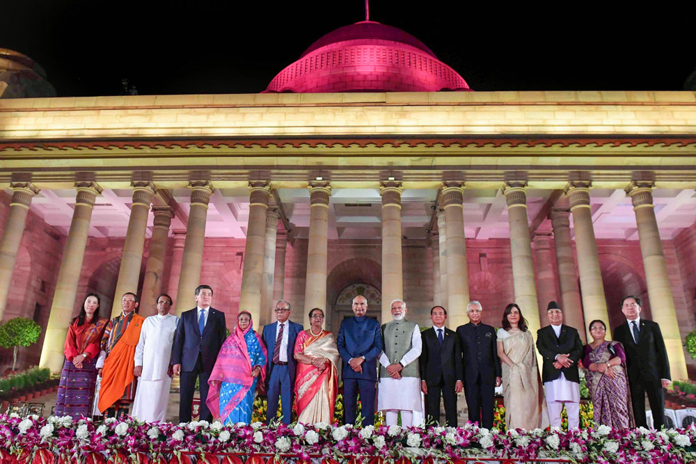 President Ram Nath Kovind and Prime Minister Narendra Modi with foreign heads of state and dignitaries at Rashtrapati Bhavan on Thursday. The practice of swearing in new governments amidst glitter and pomp that was begun by Modi arguably has a touch of the durbar of yore