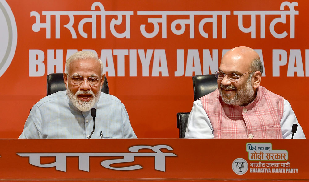 Prime Minister Narendra Modi with BJP president Amit Shah during the news conference in New Delhi on Friday