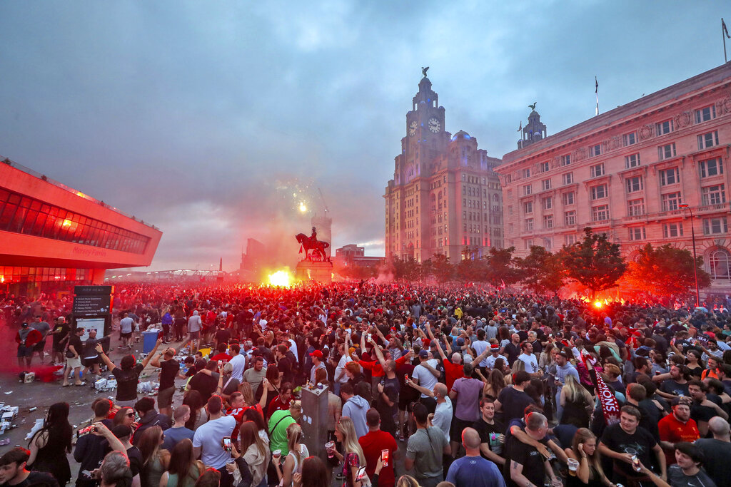 Liverpool fans let off flares outside the Liver Building in Liverpool on Friday